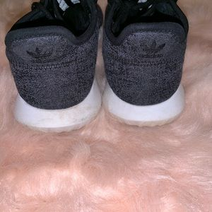 black adidas tennis shoe